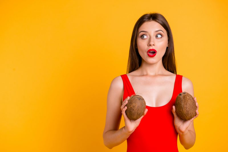 Oops I did it again! Travel resort tourism open mouth person people concept. Closeup photo portrait of shy shocked surprised amazed pretty lady holding fruit near chest isolated bright background
